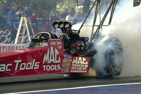 Doug Kalitta does his burn-out.