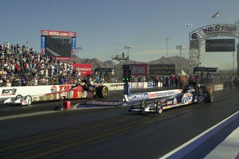 Larry Dixon and number one qualifier, Doug Kalitta, race in the final round.