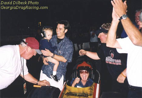 Three generations of Dixons celebrate Larry, Sr. driving at the 2003 NHRR Cacklefest. Photo by David Dilbeck