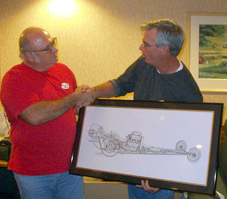 Tom West presents Bill Pitts with an autographed see-through drawing of his restored Magicar. Photo by Phil Elliott