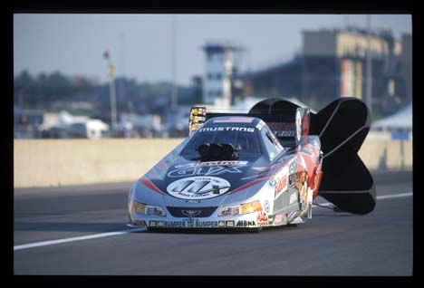 John Force pulls the chutes at Indy 2002. Photo by Ron Lewis
