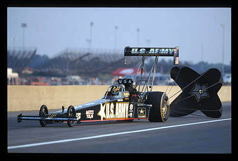 Tony Schumacher pulls the chutes at Indy 2002. Photo by Ron Lewis