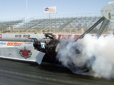 The Cowin kid smoke's 'em in the Carrier Boyz car. Car is NHRA only -- a surprise.