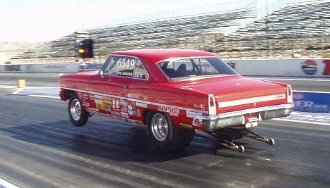 Red Chevy II launches hard.