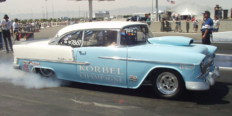 Dean Hall drives the gorgeous Korbel Champagne 55 Chevy Bel Air that has an all aluminum 565ci Donovan Chevy under its baby blue hood.