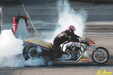 Ben Beneke burns out in his British Top Fuel Harley. Photo by Anni Valder