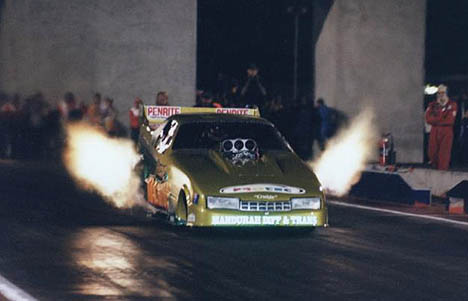Here's another angle as Dobbo gets big flames in the Greene Machine. Photo by Jon Gall