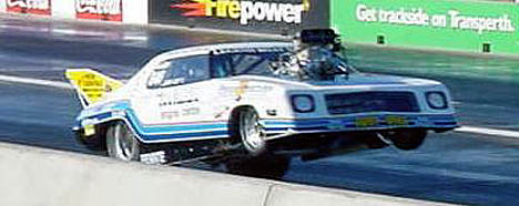 John Zappia goes into a powerstand with his 220 mph Holden Monaro. Photo by Luke Nieuwhof