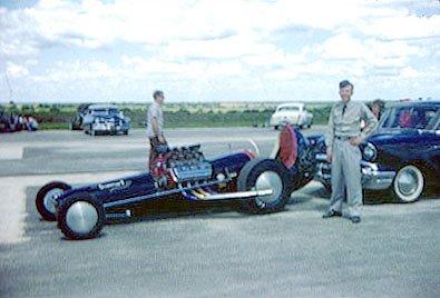 Tommy Ivo standing next to Bobby Langley's car in his boot camp uniform. Photo thanks to Tom Ivo