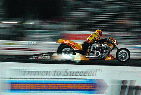 Mark Cox's Nitro Harley at the IHRA Mid Atlantic Nationals with Header Flames! Photo by Chris Simmons