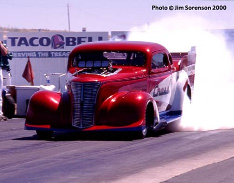 Howard Cross's '38 Chevy Pro Mod gets busy at the famous Boise Nightfire Nationals. Photo by Jim Sorenson