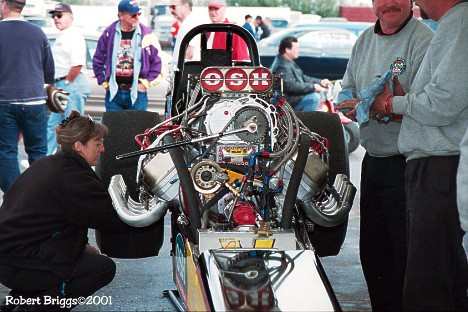 Jim Murphy's Nostalgia Top Fueler gets some between rounds maintenance at the 2001 March Meet. Photo by Robert Briggs