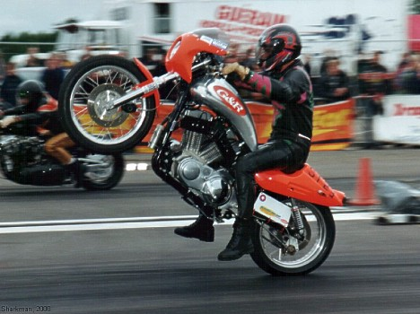 Super Twin rider shoots for the stars with a MAJOR wheelie! Photo by Sharkman