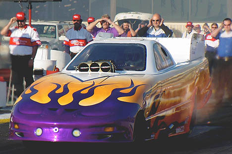 Nothing so cool as a funny car leaving the starting line. Photo by Paul Fink