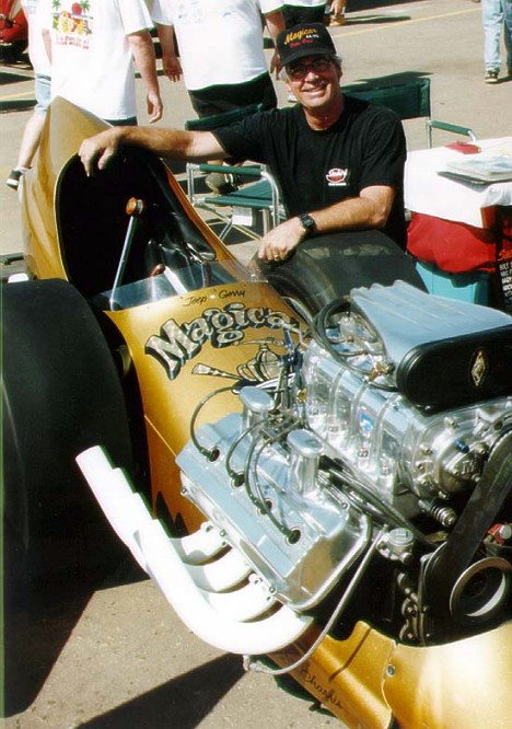 Bill Pitts is justifiably proud of his immaculate fuel dragster restoration. Photo by Jim Hill