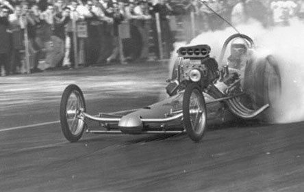 Chris Karamesines with injectors wide open and the slicks blazing. Photo from the Cagle Archives