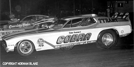 Dale Creasy 's Cobra takes on the Cassidy Bros. at one of Englishtown's famous Wednesday night match races. Photo by Norman Blake