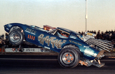 Tommy McNeely puts it sky high in the Fugitive Corvette. Photo thanks to Drag Racing Memories
