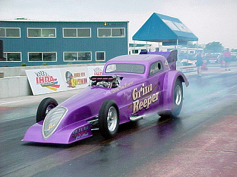 Larry Reep just keeps on truckin' with his series of purple Grim Reeper cars. Photo by Chris Graves