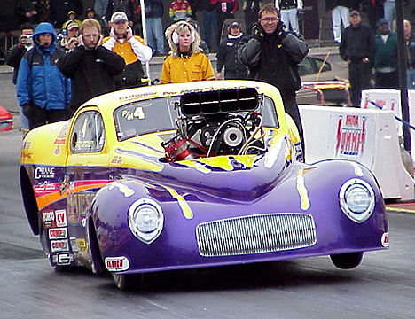 Troy Critchley has Roy Singleton's Majesty Homes WiIlys Pro Mod flying. Photo by Brian Wood