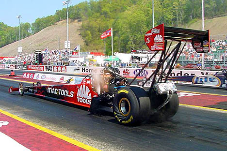 Doug Kalitta wrinkles the slicks on the Mac Tools digger at Bristol. Photo by Greg Gage