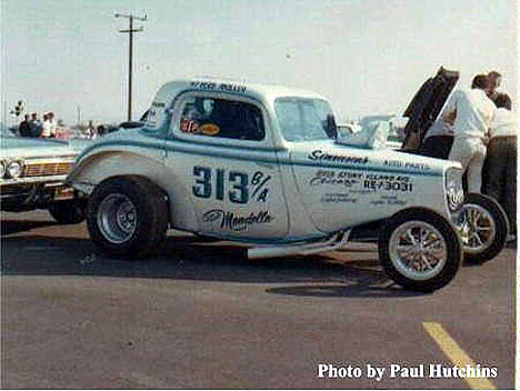 Jack Ditmars' Ford Coupe altered in the pits at Irwindale 1966. Photo by Paul Hutchins