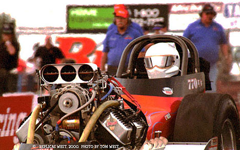 Tim Gibson leaves the line in the MasterCam nostalgia fuel dragster. Photo by Tom West