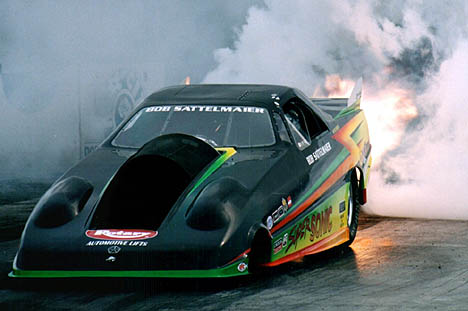 Bob Sattelmaier's Super Sonic Jet Funny Car lights up the house. Photo by Brian Wood