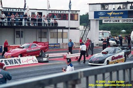 Fuel Funny Cars line up at Santa Pod Raceway in England. Photo by Anne Valder