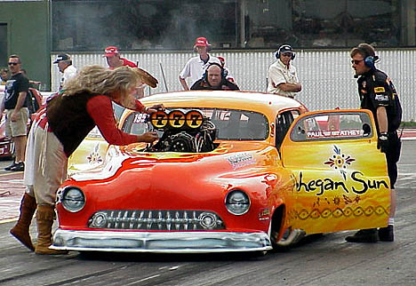 Johnny Rocca's Ironhorse Pro Mod '51 Merc has an interested onlooker in the background. Photo by Brian Wood