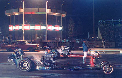 A truly beautiful sight -- two fuelers with the fuses lit under the lights. Photo thanks to Drag Racing Memories