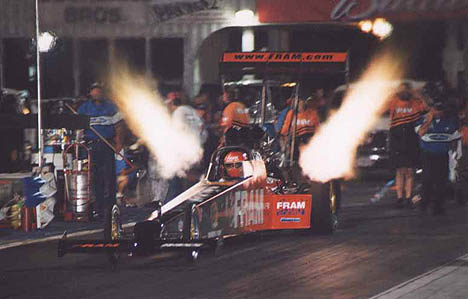 Rhonda Hartman lights up the night at NHRA Atlanta 2002. Photo by John Gulla