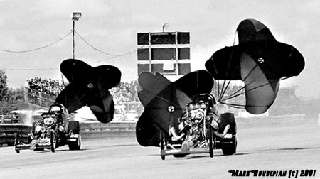 Dale Pulde and Rick McGee pop the chutes on the vintage top fuelers. Photo by Mark Hovsepian