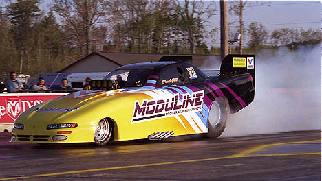 Paul Gill is one of the hardest running cars in brutal NHRA Division 1. Photo by James Morgan