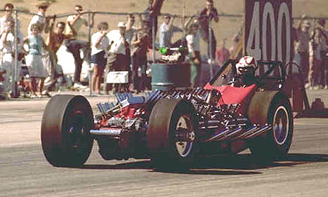 Ron Pellegrini driving TV Tommy Ivo's Four-Motor Buick Dragster in 1962. Photo by Pete Garramone
