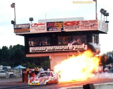 Kevin Sindel's Cargo Mate Funny Car tries to burn down the Moroso tower! Photo by Gonzo