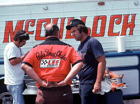 "Ed ""The Ace"" McCulloch confers with Bob Farmer at the 1974 Summernationals. Photo by Peter Kumble"