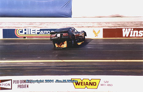 John Collins does a gut check as he wrestles his flaming Z Car into a spin. Photo by Jim White