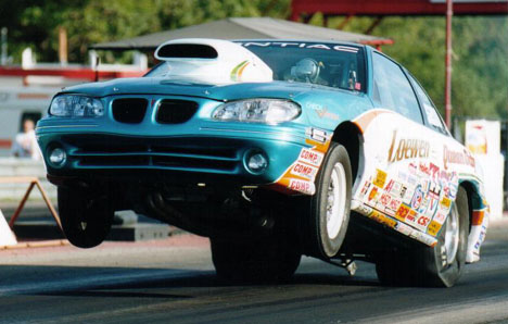 Abe Loewen goes skyward in his Super Stock '98 Grand Am. Photo by Blair Alderton