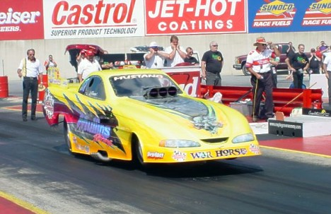 Bruce Mullins became the quickest Roots car in the NHRA with a 5.80, 240 blast at Reading. Photo by Greg Gage