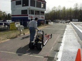 Dad leads Jason back to the staging lanes after a time run. Photo by Tim Pratt