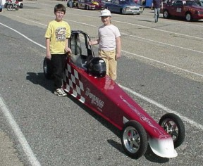Jason and Emily pose with the Putnam Race Cars Dragster. It won't be long, Emily! Photo by Tim Pratt