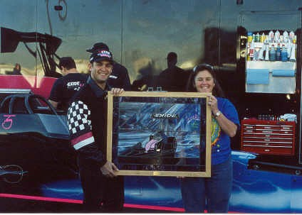 Laurie Watts presents Tony Schumacher with a stained glass picture of the Exide Top Fueler. Photo thanks to Laurie Watts