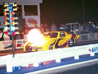 Barney Squires suffers a huge nitrous backfire in Johnny Foltz's Outer Limits Corvette. Photo by Greg Gage