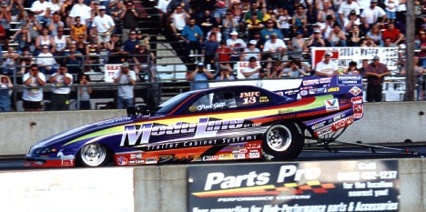 Paul Gill's screw blower equipped ModuLine funny car completely dominated the action over its Roots-blown competitors. James Morgan photo