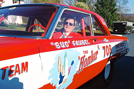 "Bud Faubel sits behind the wheel of his car, the ""Honker."" Photo by Greg Gage"