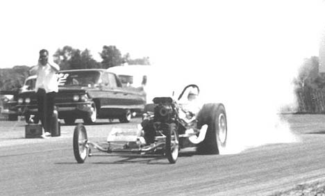 Dave Anderson burns out in his Top Fuel Dragster in 1965. Photo thanks to Ron Johnson