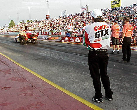 John Force checks out the Pro Mod action at Gainesville. Photo by Brian Wood