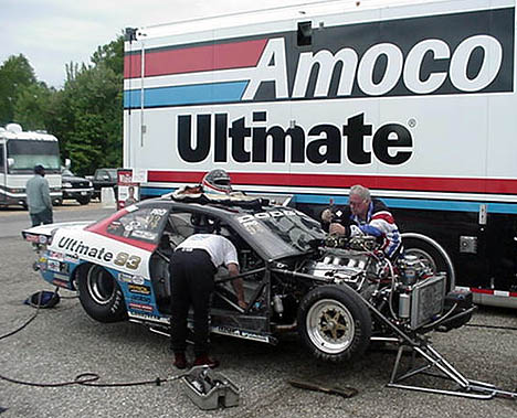 The Johnson Racing team works on the big Hemi between rounds. Photo by TIm Pratt