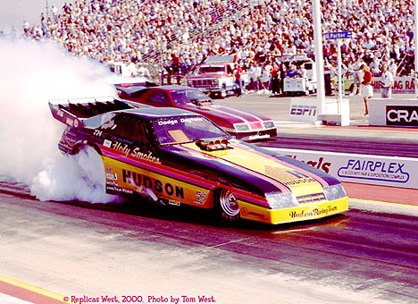 Tom West has been part of the SoCal scene for years. Here he shoots Jim Murphy's Funny Car in around '88 or '89. Photo by Tom West